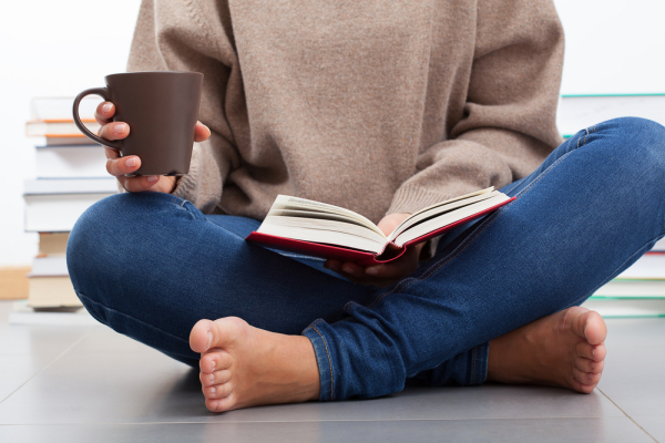 Woman relaxed reading a book.